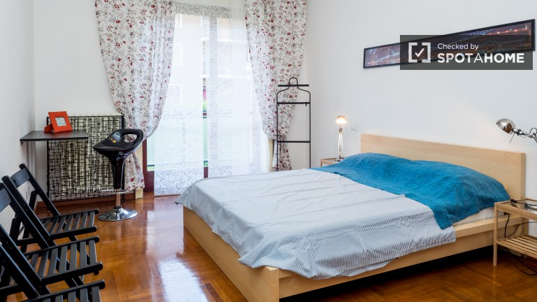 Bedroom 2 with double bed, AC, balcony and ensuite