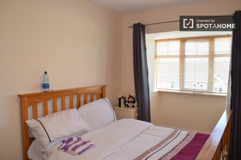 Bedroom 2 with double bed and built-in wardrobe