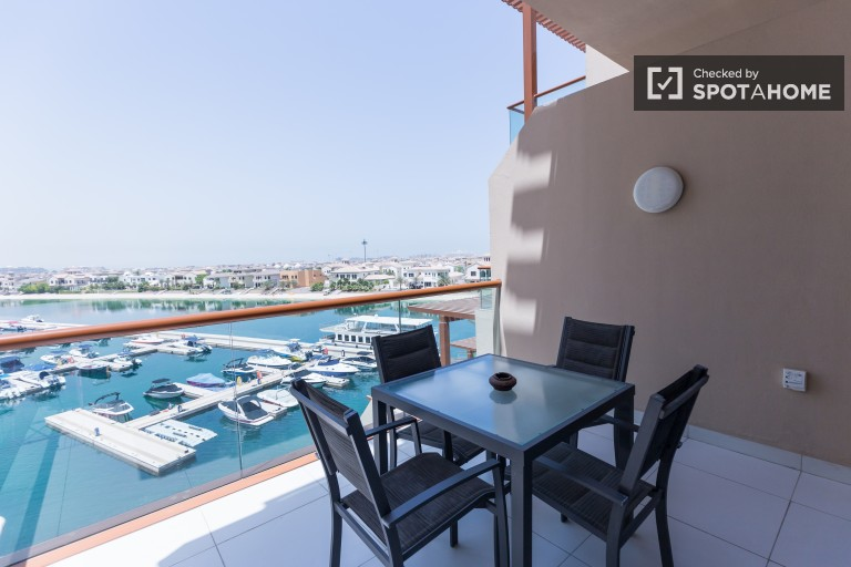 Stylish studio apartment with balcony offering amazing views of the sea