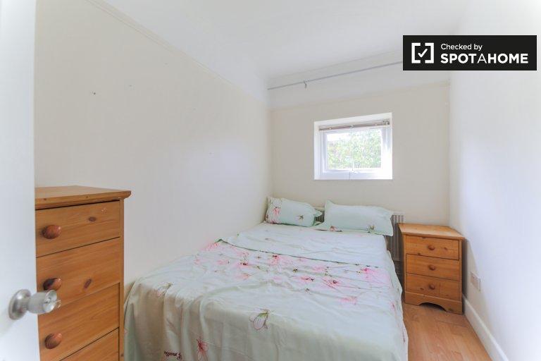 Chambre soignée dans un appartement de 4 chambres à Wimbledon, Londres