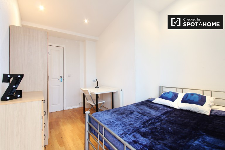 Bedroom 2 with double bed and terrace access