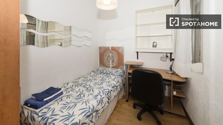 Bedroom with sliding-door wardrobe