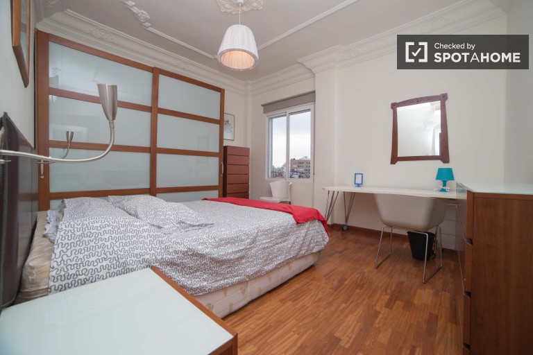 Spacious bedroom 2 with double bed and exterior views