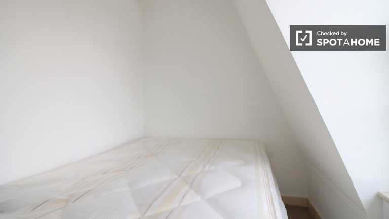 Bedroom 1 with double bed and heating unit