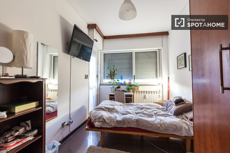 Bedroom 3 with large single bed and balcony