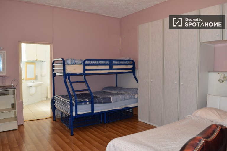 Bedroom 14 with double bed and bunk bed