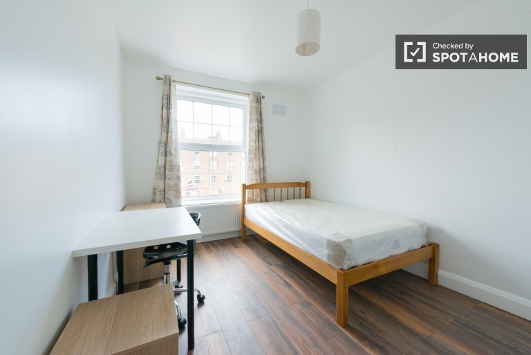 Bedroom 5 with double bed and standalone wardrobe