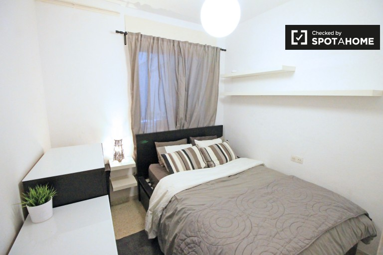 Bedroom 2 with double bed and AC