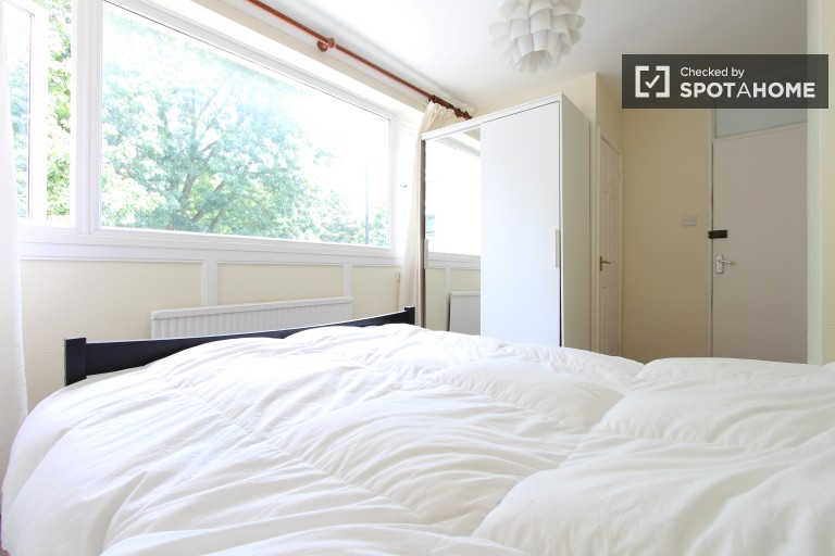Bedroom 1 with double bed and en-suite bath