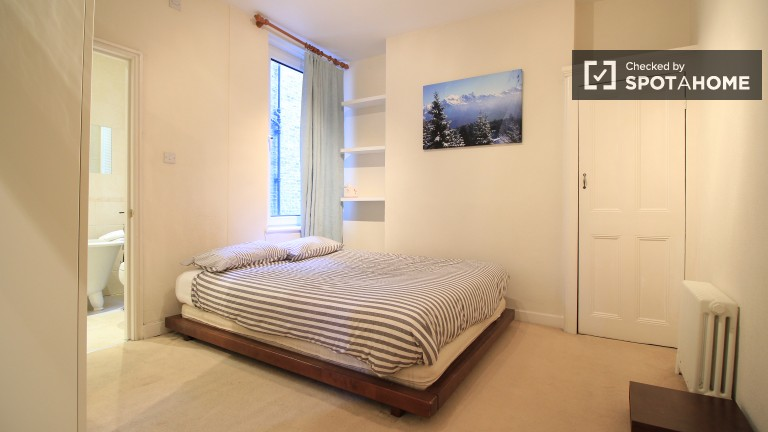 Bedroom 1 with double bed and en suite