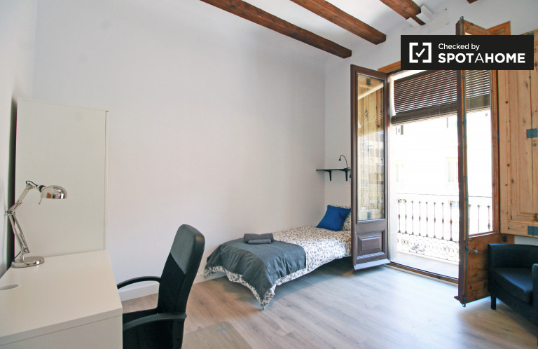 Bedroom 1 with single bed and balcony