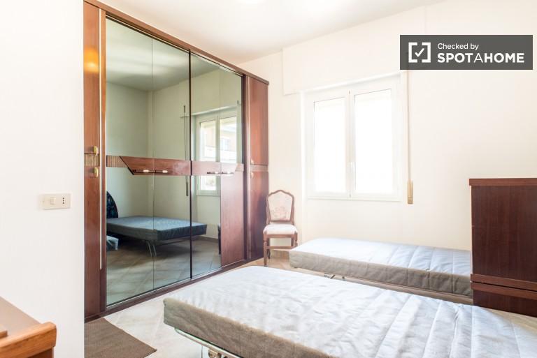 Bedroom 3 with twin beds and en-suite bathroom