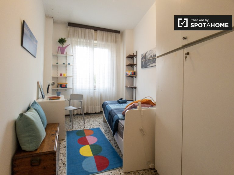 Bright room in 4-bedroom apartment in Bicocca, Milan