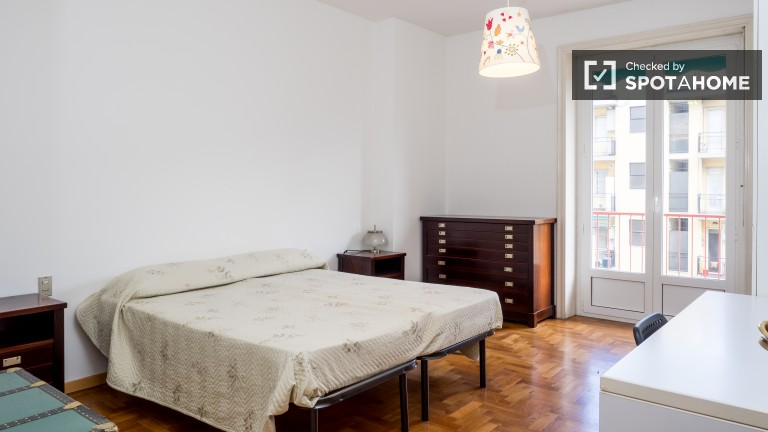 Bedroom 1 with double bed and balcony access