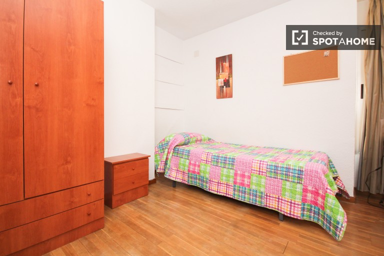 Bedroom 2 with single bed and balcony