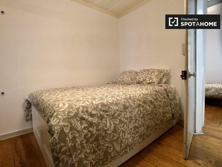 Bairro Alto 4 yatak odalı dairede kiralık rahat oda