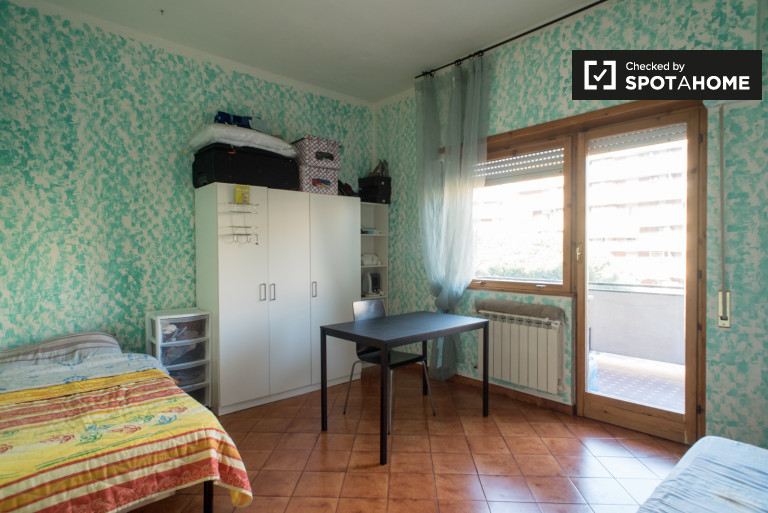 Bright room in 3-bedroom apartment in Cinecittà, Rome
