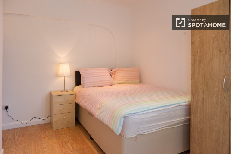 Bedroom 1, couple-friendly with double bed and en-suite bath