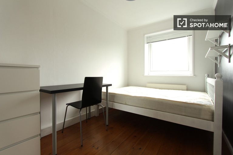 Bedroom 5 with double bed and desk