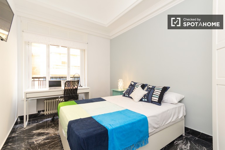 Bedroom 2 with double bed and exterior view