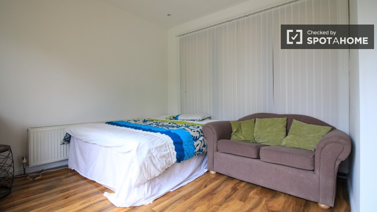 Bedroom 1 with double bed and balcony
