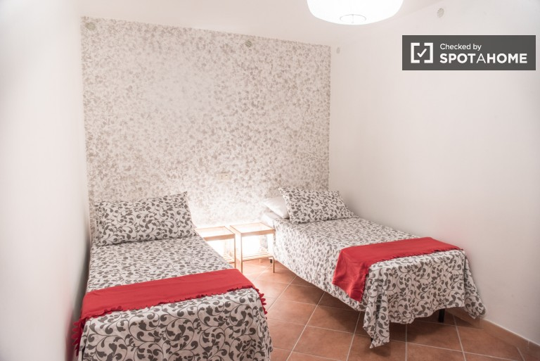Modern room in 4-bedroom apartment in Tor Pignattara, Rome