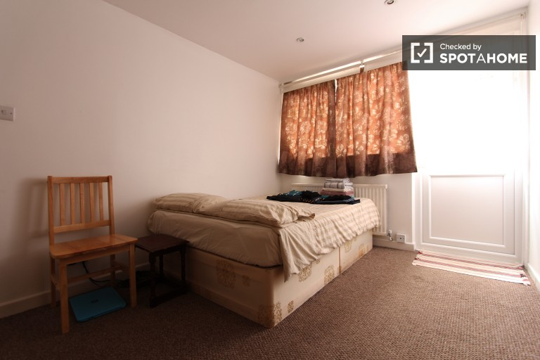 Bedroom 1, couple-friendly with double bed and terrace