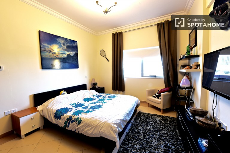 Bedroom 2 with double bed and ensuite bathroom