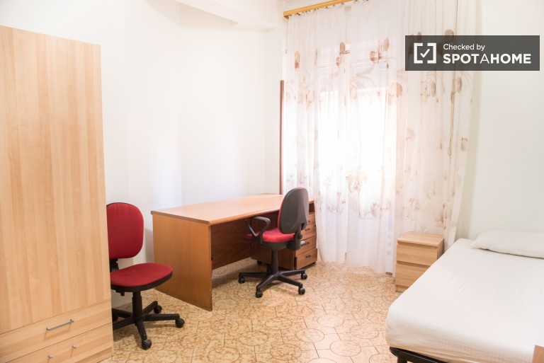 Large room in 4-bedroom apartment in Tuscolano, Rome