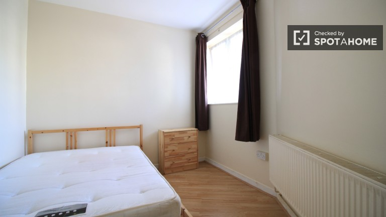 Bedroom 4 with double bed and heating unit