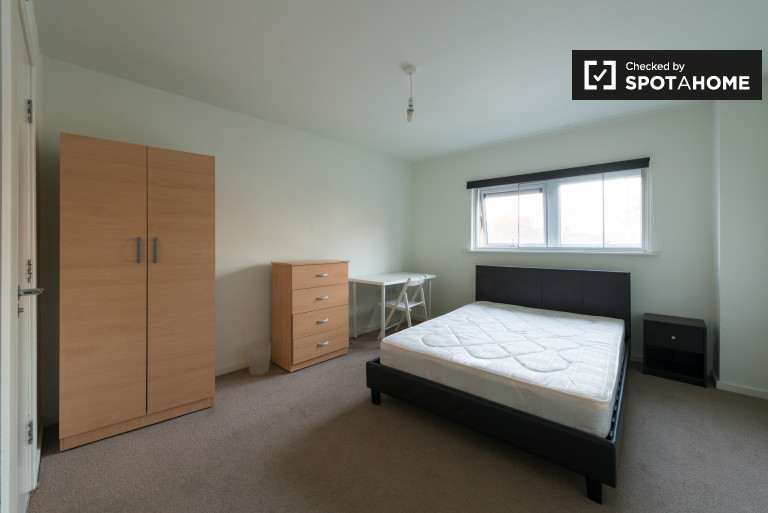Bedroom 2 with a double bed and ensuite