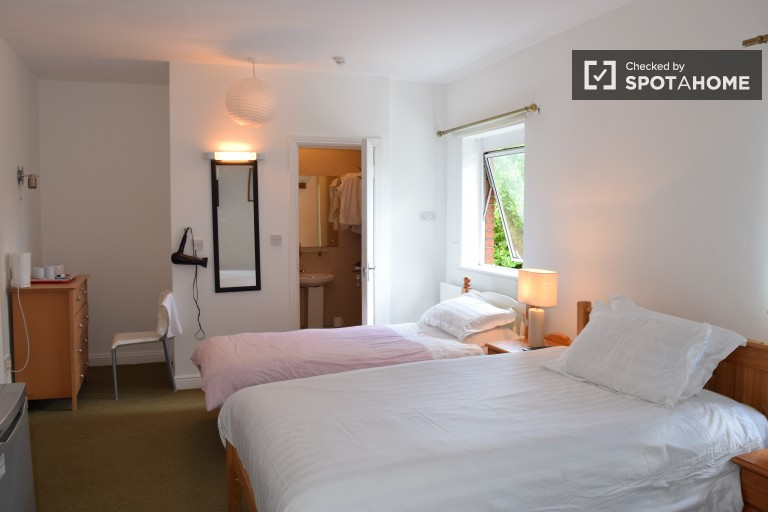 Bedroom 5 with 2 double beds and 1 single bed in shared occupancy room