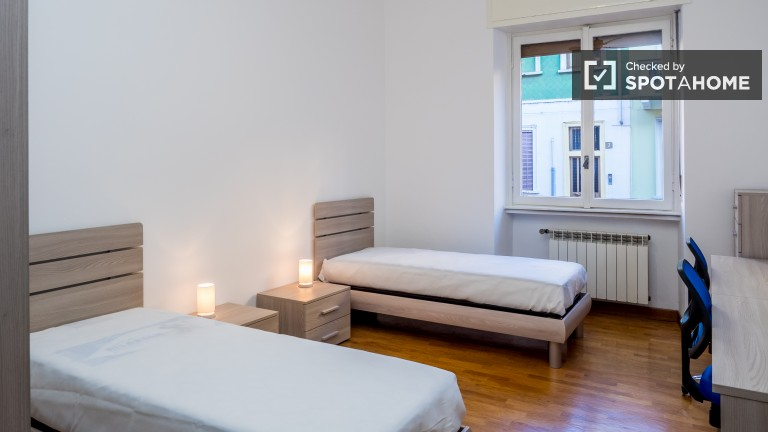 Bedroom 2, couple-friendly with 2 single beds