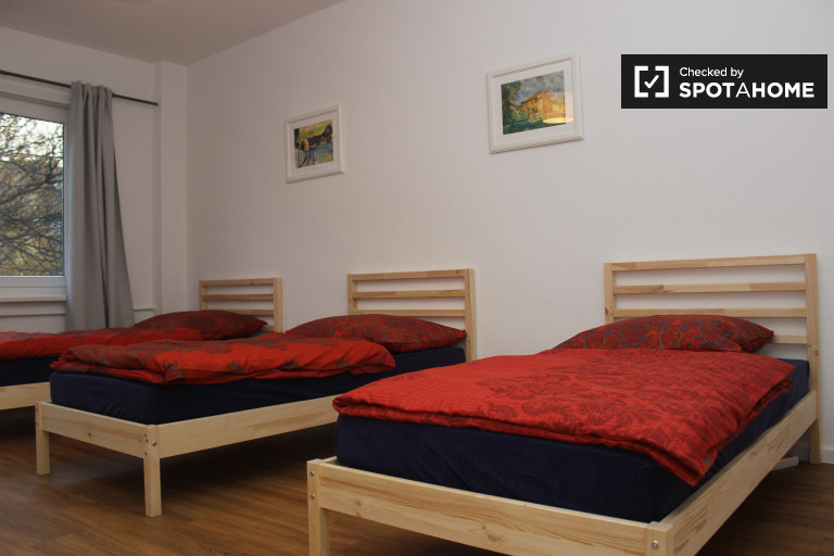 Bedroom 3 - a shared-occupancy room with 3 single beds for rent