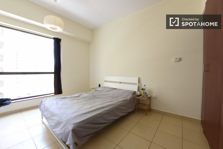Double Bed in Fully furnished rooms for rent in an 8-bedroom apartment in Dubai Marina, close to the beach
