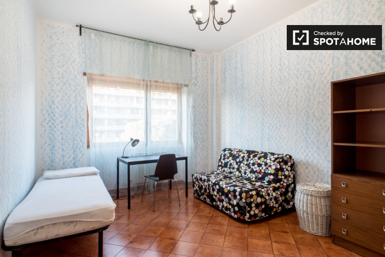 Spacious room in 3-bedroom apartment in Cinecittà, Rome