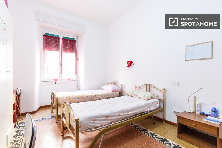 Bedroom 1, couple-friendly with 2 single beds and desk