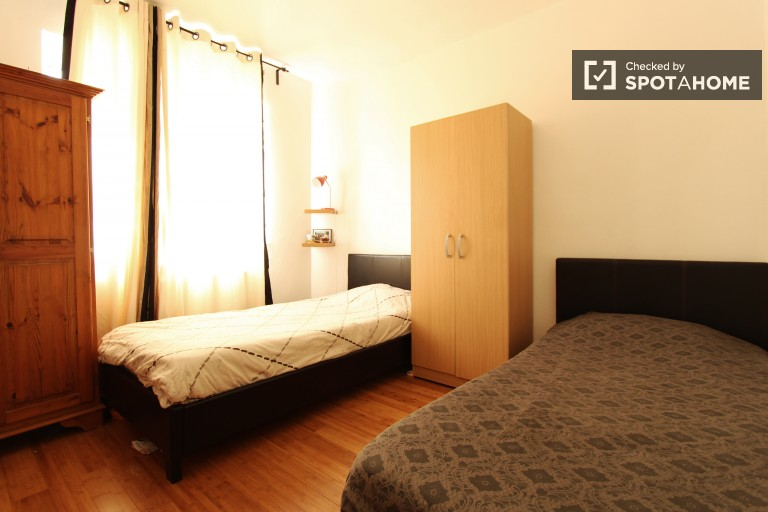 Bedroom 2, couple-friendly with 2 single beds and storage