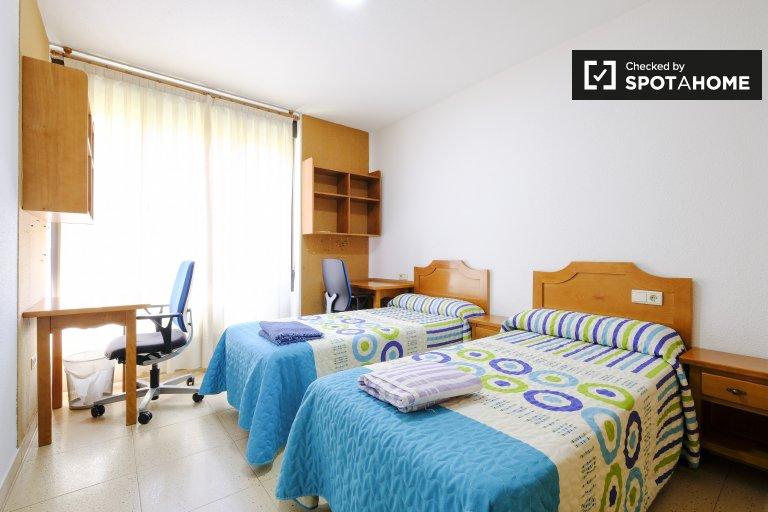 Camas em quarto compartilhado no residence hall em Almagro & Trafalgar