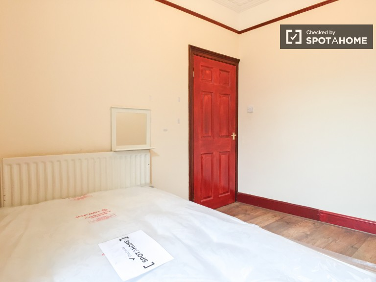 Bedroom 2 with double bed and standalone wardrobe