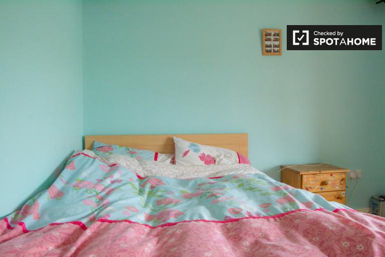 Bedroom 4 with double bed and en-suite bathroom