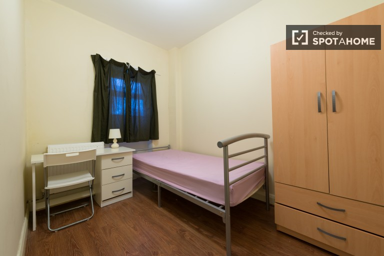 Bedroom 2 with single bed and ensuite bathroom