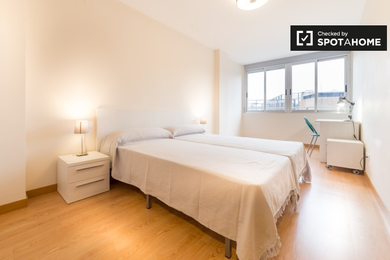 Bedroom 2, couple-friendly with 2 single beds and en-suite bathroom