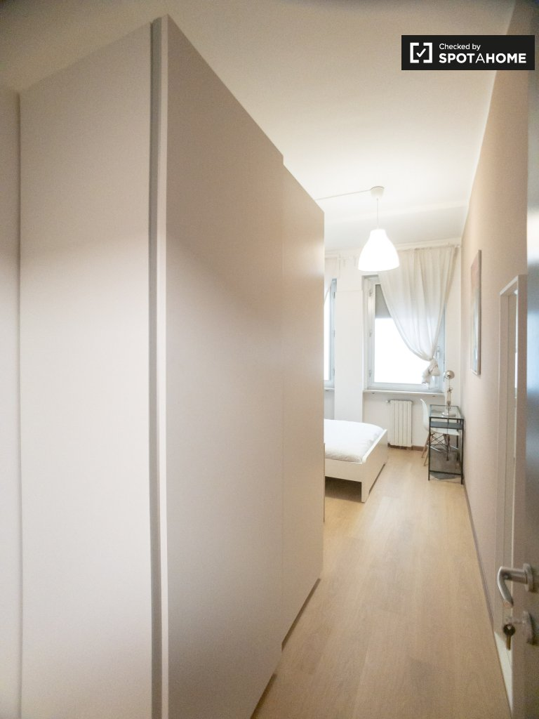 Chic room for rent in 12-bedroom apartment in Bicocca