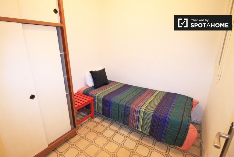 Bedroom 1 with single bed and heating