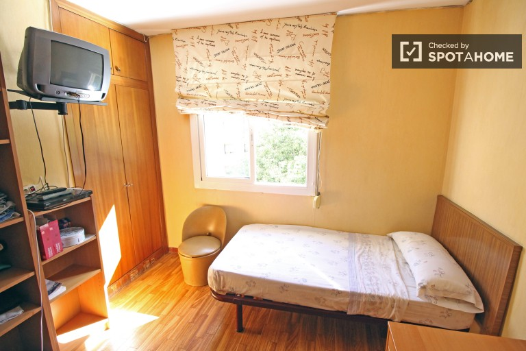 Bedroom 1 with single bed and TV