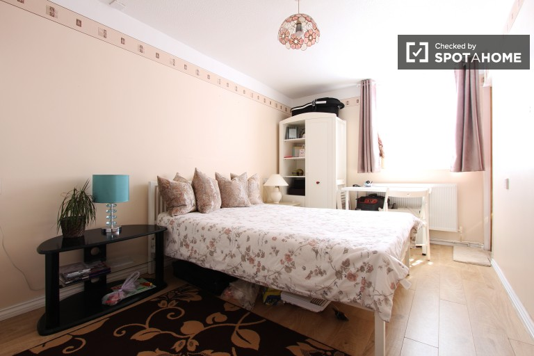 Bedroom 1 with double bed and 2 wardrobes