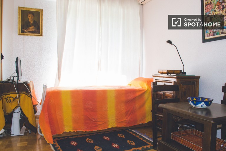 Bedroom 1 with single bed and television