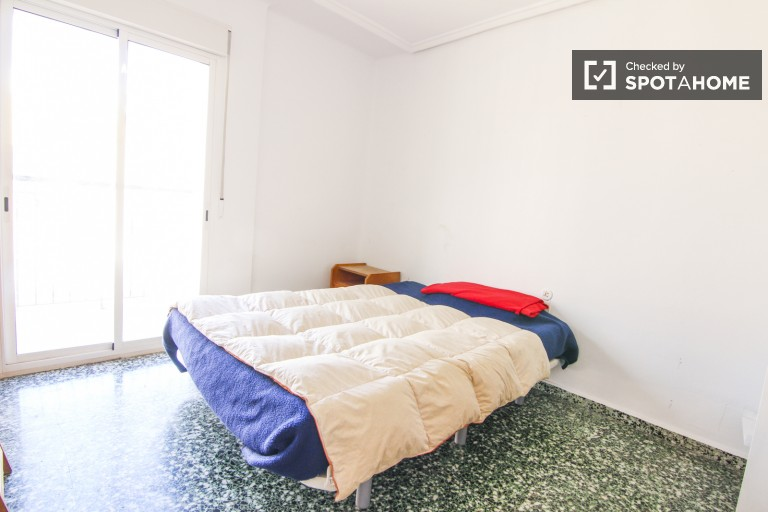 Double bedroom with built-in wardrobe and shared exterior balcony
