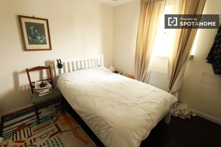 Bedroom 1 with double bed and private bath
